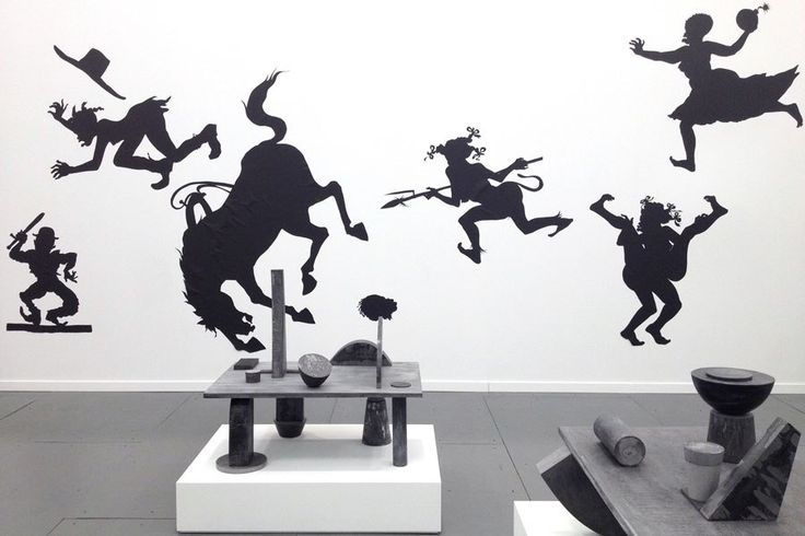 On the wall is Auntie Walker's Wall Sampler for Savages, 2013, by Kara Walker.