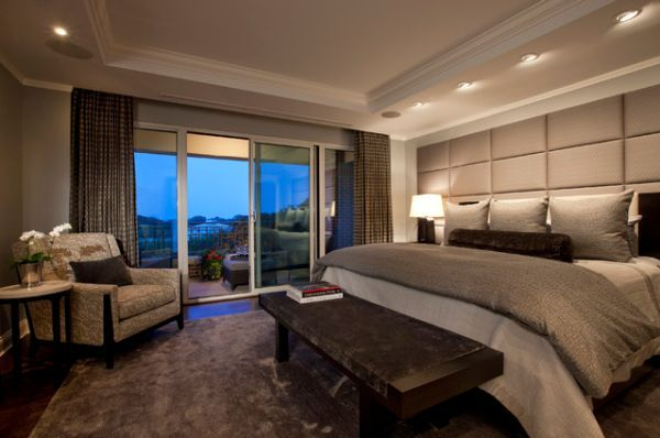 Stylish bedroom with sliding glass doors and panoramic balcony views
