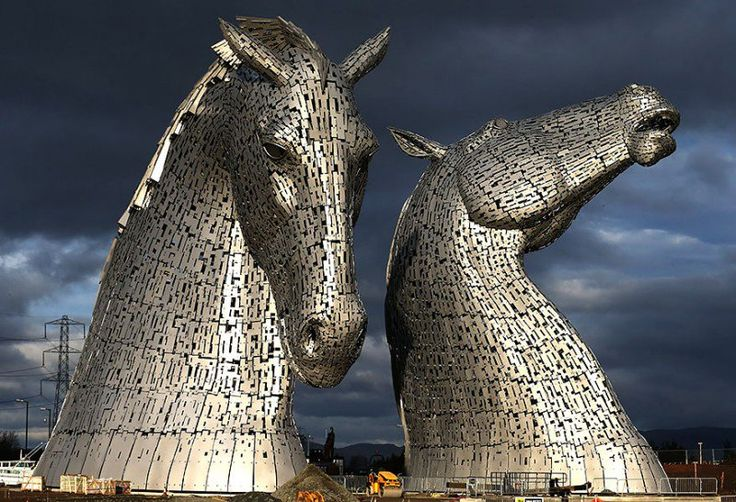 SCOTLAND – The Kelpies (2013) by Andy Scott. These 98.4 feet (30 metre) high sculptures are located near the conjunction of the Forth and Clyde Canal and the River Carron in The Helix parkland in the Falkirk Council Area, Great Britain, UK. https://www.google.ca/maps/place/Kelpies/@56.0185456,-3.7602069,16z/data=!4m5!3m4!1s0x48887977108eb923:0x3c856e4052cabcf7!8m2!3d56.0191783!4d-3.7554862