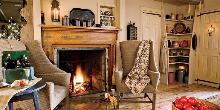 arredamento-soggiorno-camino-stile-rustico-poltrone-classiche-colore-beige