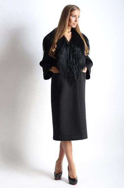 Luxurious free size neoprene black coat with a yak fur collar and pockets from Anna Stevar. Closes with buttons.  The fabric withstands temperature up to - 10 degrees. It is water resistant.
