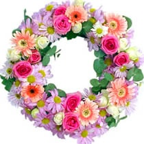 A sensible wreath of mixed flowers such as gerberas freesias sweet William and roses in pastel colors to express your heartfelt condolences. Send it now for only $120. For more please visit http://www.flowersnext.com/florist/category/sympathy.asp