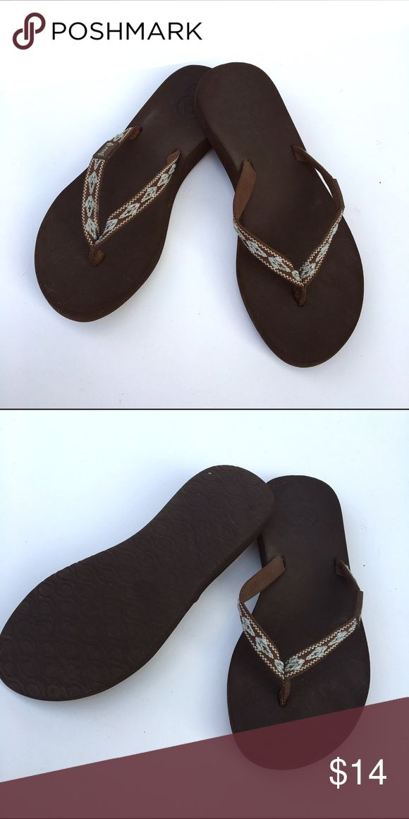 Women's Reef Flip Flops Brown flip flops with a blue embroidered design. Very comfortable and still in good condition. Shoes Sandals