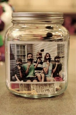 """""""year in a jar""""   put a cute family picture in a jar; display it; throughout the year drop little items that represent your year (ticket stubs, hospital wrist band, a card, a """"lucky rock"""" from a vacation, love note, pics, etc) - what a fun idea!"""