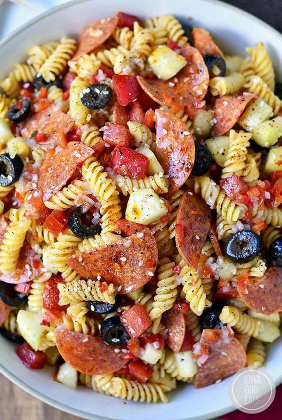 Pasta Salad Recipe - The BEST old fashioned pasta salad with pepperoni, olives, veggies and italian dressing! The perfect side dish to bring to your next potluck or barbecue! Recipe via Iowa Girl Eats