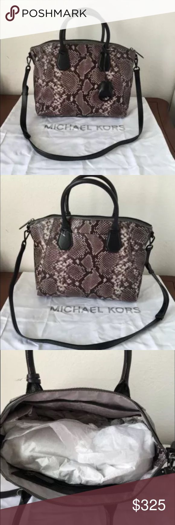 "MICHAEL KORS RILEY PYTHON EMBOSSED LEATHER SATCHEL COLOR:   Steele Gray Interior center divider zip pocket, side zip pocket and Cell phone/multifunction pockets, key clip Exterior gun metal tone hardware detailing, key fob hanging  	Magnetic button closure pocket on back 	Bottom feet 	Fabric lining  	Double handles with detachable adjustable shoulder strap 	4.5"" and 18"" drop  	16"" 1/2 (top) 13"" (bottom)(L) 11""(H), 6""(D)  	 Retails:  $448 with price tag and dust bag MICHAEL Michael Kors Bags…"