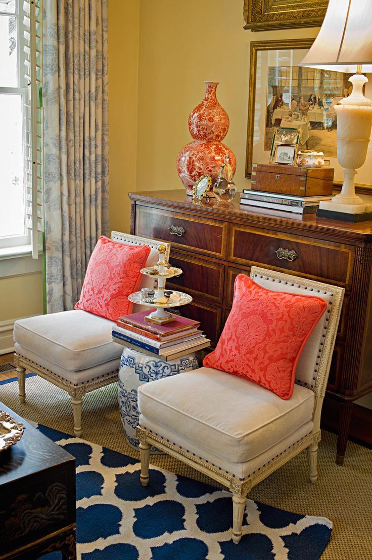 A pop of coral color and a bold graphic rug bring a fresh contemporary feel to this room.: Interior, Living Rooms, Coral Navy, Color Combination