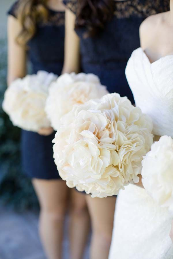 Navy bridesmaid dresses and hydrangea bouquets.