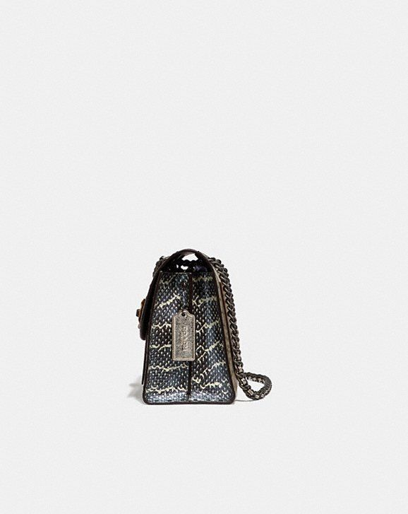085878cff7 Coach Parker in Signature Canvas With Rivets and Snakeskin Detail Alternate  View 1