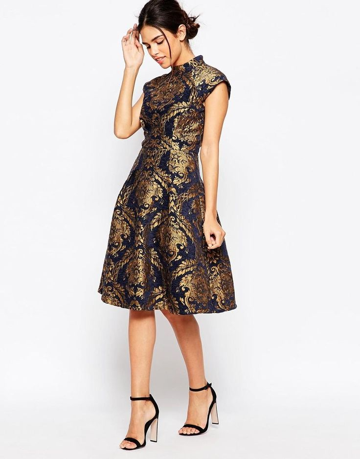 10 Gold Dresses to Wear on New Years Eve - Chi Chi London High Neck Structured Skater Dress In Baroque Print, $125.41; at ASOS