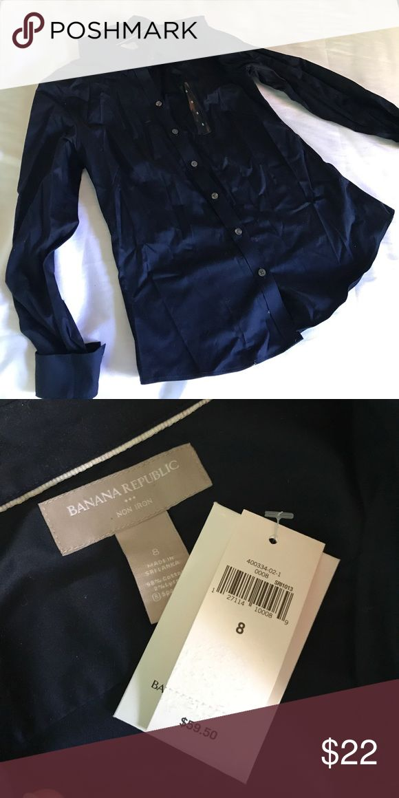 NWT Banana Republic Non Iron Dress Shirt 8 Navy NWT Banana Republic Non Iron dress shirt in size 8 and navy blue color. Wrinkled due to storage. Never worn and no flaws. Original price $59.50. Banana Republic Tops Button Down Shirts