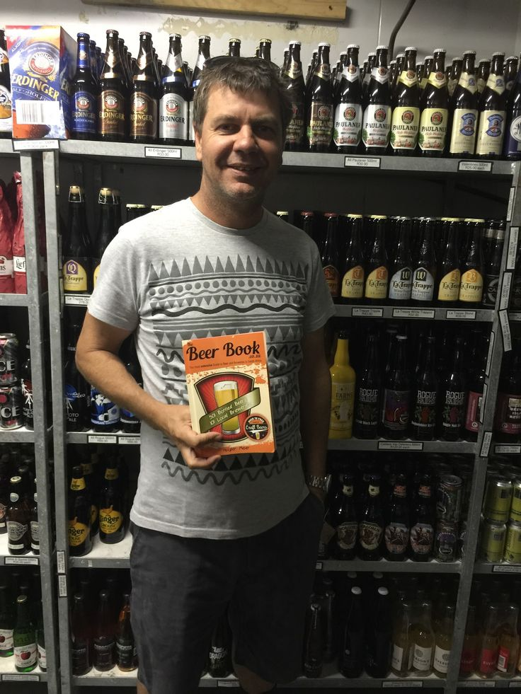 Manie Potgieter shows of the extensive beer collection at Roeland Liquors, Cape Town.  Most of these beers are covered in The Beer Book.