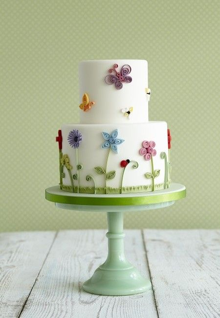 Garden party theme cake. Perfect for celebrating a birthday. By Zoe Clarke.