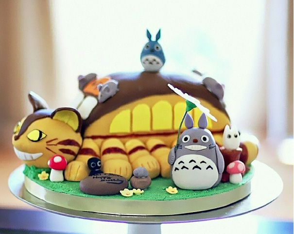 Totoro Cake - Totoro, everyone's favorite big, loveable forest spirit, is one of the best (and tastiest) ways to decorate a cake for any occasion, especially a birthday! This Japanese animated classic by Studio Ghibli reminds us to nurture our inner child, and there's no better way to do that than with a big slice of Totoro cake!