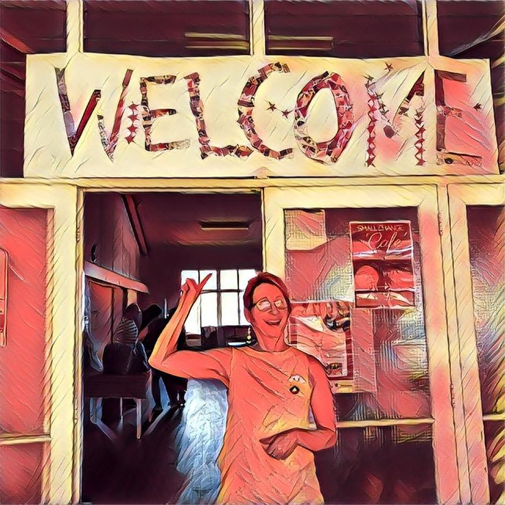 One of our staff/volunteers Robin creating a colourful welcome to our Culture in the Cafe on Monday.
