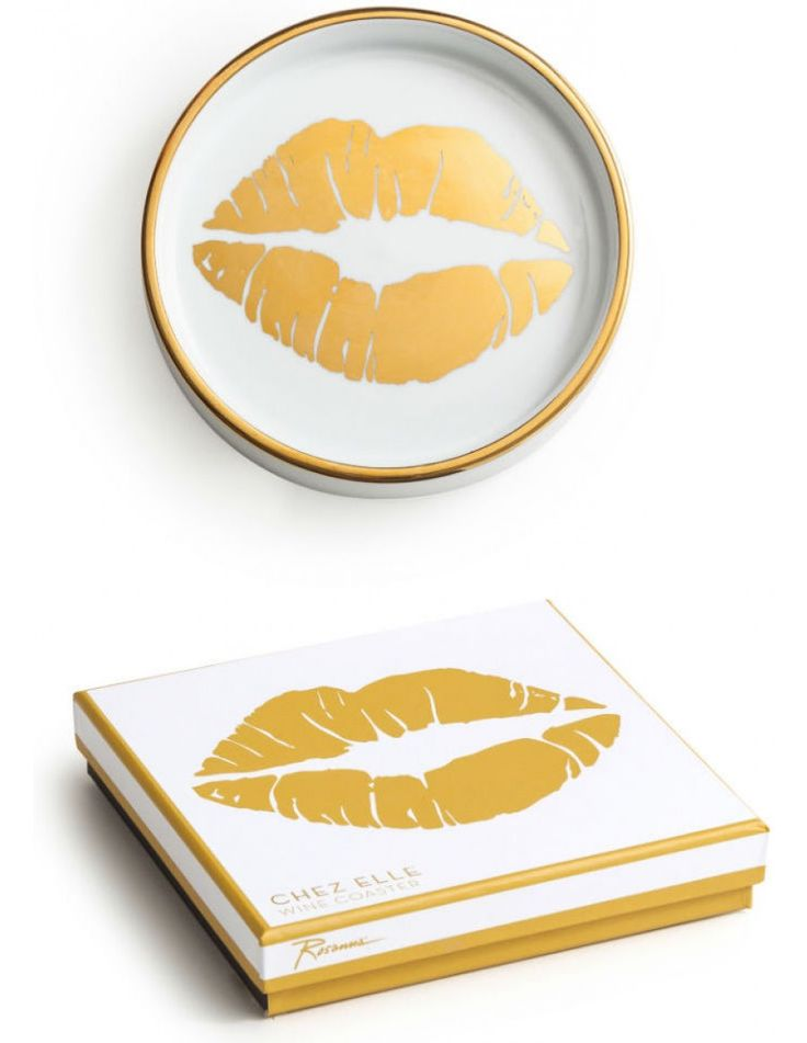 Chez Elle, have you been? Pour yourself a cocktail and revel in her eclectic style where unlikely pairings somehow look just right. The Gold Kiss Wine Coasterl will add a stylish flare of elegance to your drinking habits. One coaster in a gift box. Made of porcelain with gold detailing.