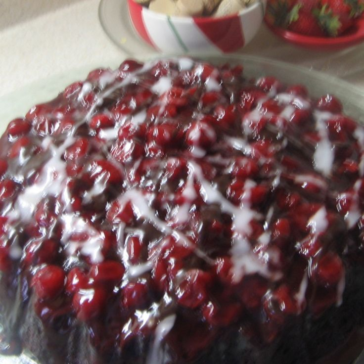 i made this cake for a friend of mine today..she said she liked cherry pie and chocolate cake..so I put the 2 together..and Mmmmmmm. This cake can be made with other cake mixes and prepared pie fillings... combinations are unlimited...this is quick and  easy...