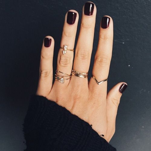 A fresh manicure and stacked rings with a cozy sweater.