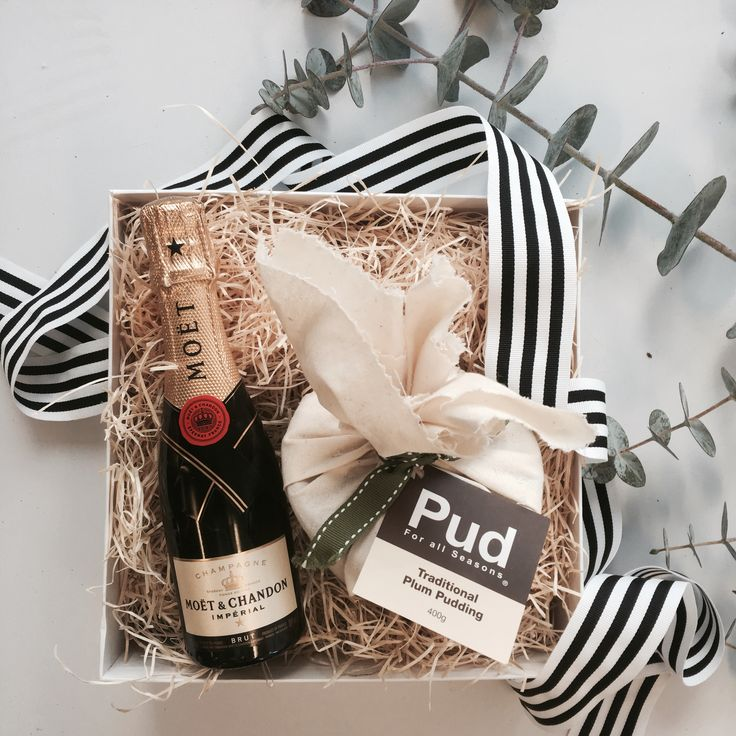 Christmas Gifts and Hamper ideas. The perfect little combination of bubbles and sweetness. This gift includes:  - Moet & Chandon Brut Piccolo  - Pud for All Seasons Traditional Pudding 400gm  - Caramelicious Gourmet Soft Caramel  A lovely gesture over the festive season.  Packaged in an exclusive Gifting Co box with black & white stripped grosgrain ribbon & swing tag.