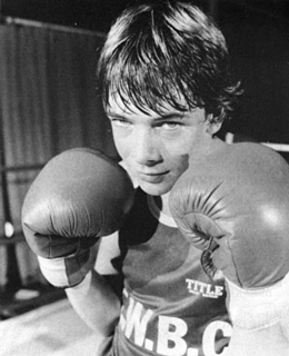 Ian Beale took up boxing in 1985 in an effort to impress his dad, Pete, as well as the ladies. Ian won his match, but the only lady he impressed was little Cassie Carpenter, kid sister of Kelvin, and Pete ignored Ian to shower accolades onto Simon Wicksy, who helped Ian train for the fight. Poor Ian...