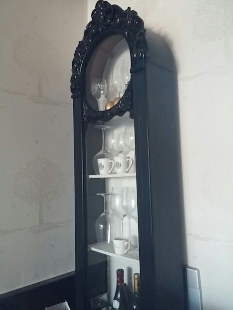 Repurposed grandfather clock. I just added 3 shelves.