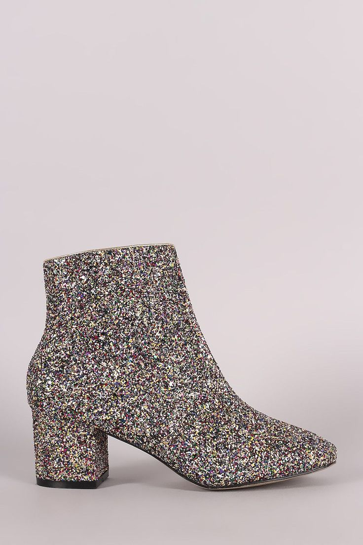 These chic booties feature a colorful glitter throughout, rounded square toe silhouette, and block heel. Finished with a cushioned insole, smooth lining, and side zip closure. Material: Glitter (man-m
