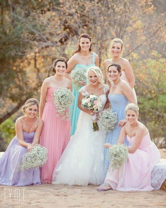 The prettiest pastel bridesmaid dresses with baby's breath bouquets!