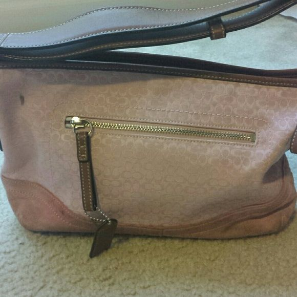 Pink Coach shoulder bag Very preloved condition with marks on both sides of purse. The purse is leather with pink fabric . Bottom is suede fabric shows signs of usage. The leather and silver hardware are in perfect condition. The inside the purse does have some stains. Three inside pockets and one out side pocket. This is was bought at a coach outlet store many many years ago. Coach Bags Shoulder Bags
