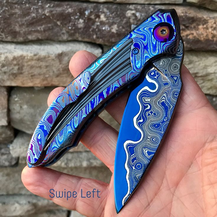 MARTIN MONDAY……….SCORE from Blade 2017……..This Beautiful new Model from the shop of Peter Martin and designed by his son Cory Martin. This is the New XRS Model with Beautiful Zircuti Scales, and Pocket Clip. The Scales have Inlaid Fluted Zirconium Inlays. The Blade and Floating Backspacer are Peter's Sole Authored Lava Lamp Damascus, beautifully hot Blued. The liners are Deep Blue Anodized Titanium. The Fit & Finish are nothing short of PERFECTION! A beautiful addition to my Peter Martin...