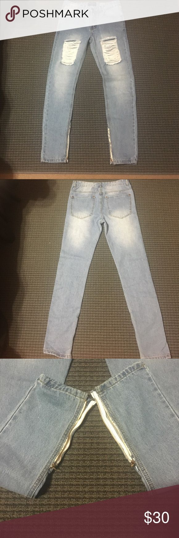 distressed denim jeans A brand new, never worn light wash pair of jeans with added zippers at the hem. Willing to negotiate Boohoo Jeans Skinny