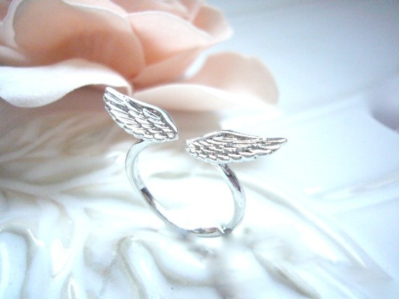 darling angel wings ring. Must get this for Kayla