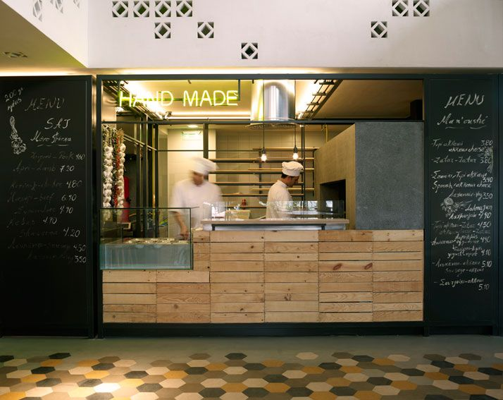 SOUK   A 24-hour Lebanese Food Market And Restaurant by K-studio Timber counter front and Tiled floor