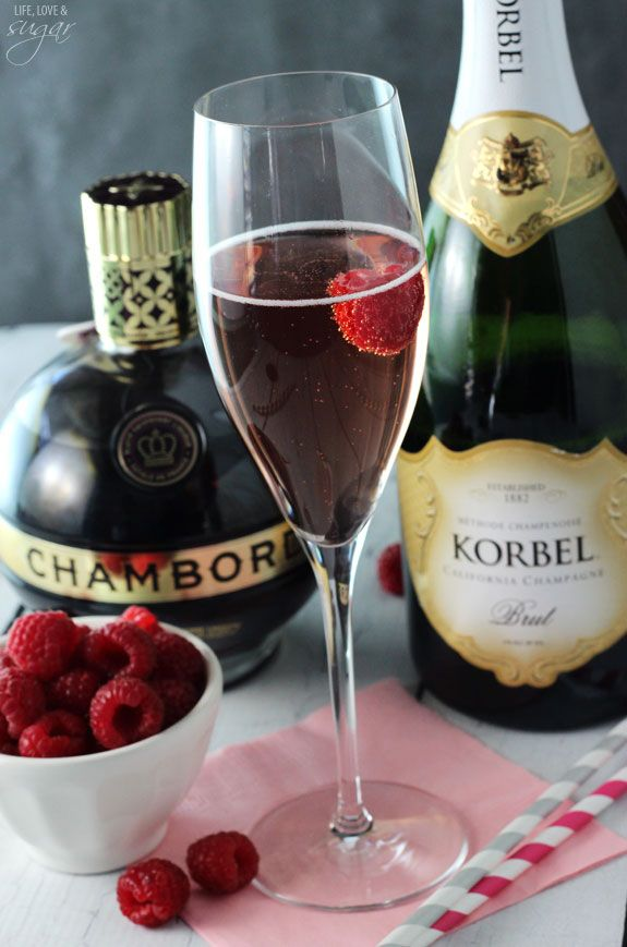 Blackberry Champagne Bellini - 4 oz champagne, 1/2 oz Chambord, fresh raspberries - Pour Chambord into the bottom of the champagne flute. Add champagne and a raspberry to the glass and serve.