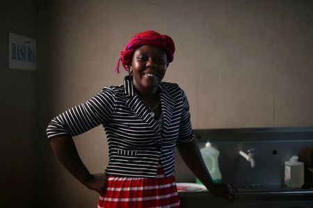 Haitian migrant, Naomi Josil, 29, poses for a photo inside the kitchen of the Juventud 2000 shelter after leaving Brazil, where she relocated to after Haiti's 2010 earthquake, in Tijuana, Mexico