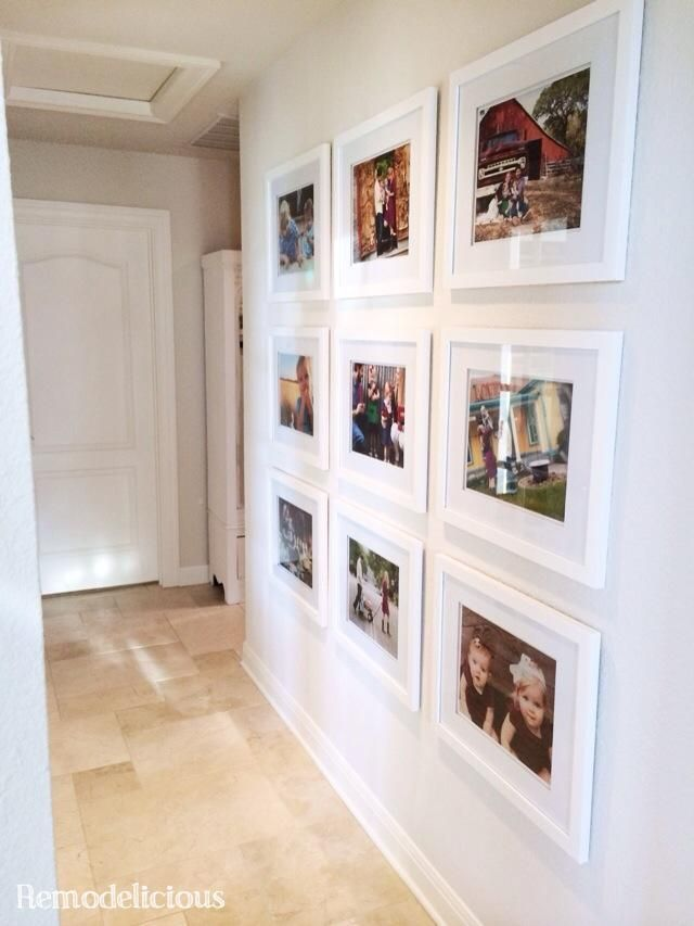Family photo wall gallery with budget white frames.