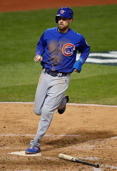 Ben Zobrist of the Chicago Cubs scores a run during the fifth inning against the Cleveland Indians in Game Two of the 2016 World Series at...
