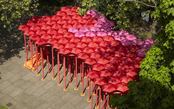 SPRING FOREST A surreal red and pink forest of thin poles topped by umbrellas, offering shaded comfort, away from the city frantic pace. Red foam-clad scaffolding components formed a glamorous example of reversible temporary public environment Reversing the perception of umbrellas as symbols of weather threat, this temporary architecture filtered the Spring light through the unusual canopy, creating an invigorating atmosphere for all visitors. It celebrates the physical experience of the…