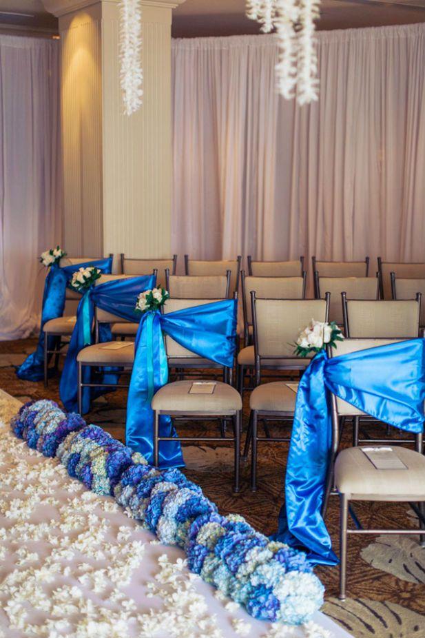 Elegant white and blue wedding ceremony setup (Photo by Clane Gessel Photography)