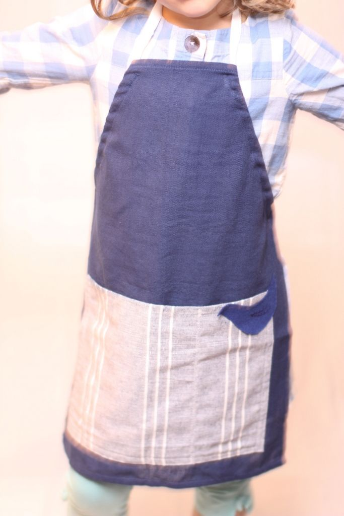 Navy blue linen apron with pale blue linen pockets. Suitable for baking or art activities. Decorated with a bluebird with hand embroidered detail. Length - 48 cms Price £8