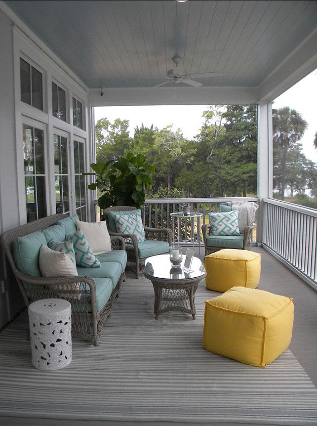 A calming, beach-house style front porch decorated in blues and grays with a burst of yellow. | Designed by Our Town Plans