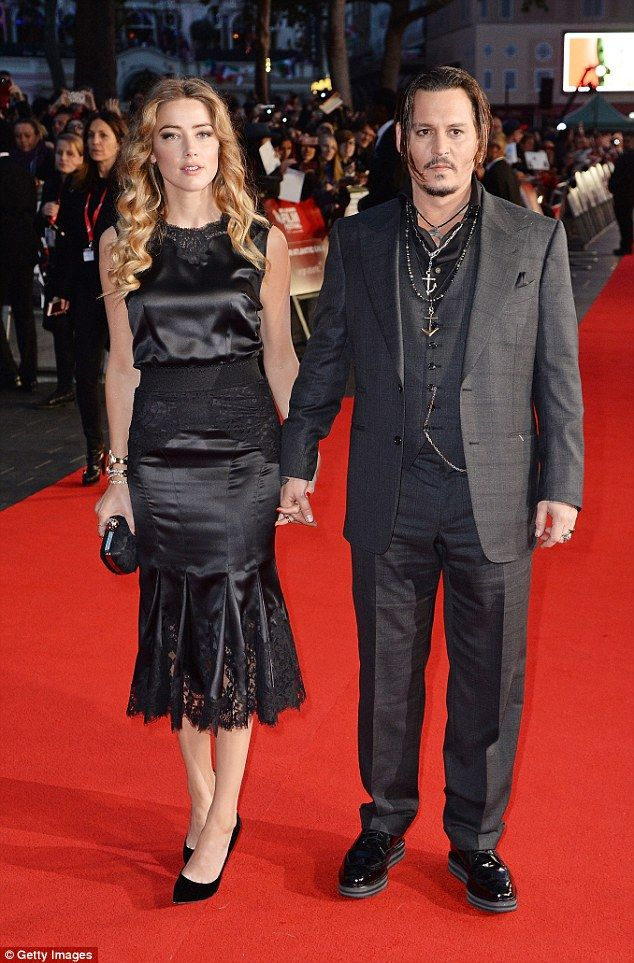 Show of support: Amber Heard went hand-in-hand with her husband Johnny Depp at the BFI Lon...