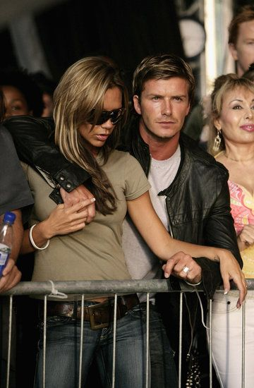 David Beckham had his arm around Victoria while watching Live 8 London in July 2005.