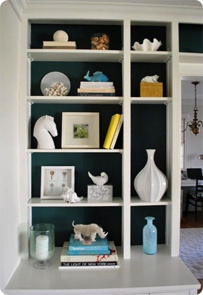 The Dark Painted Bookcase Back Allows For Books And Accessories To Have A Voice