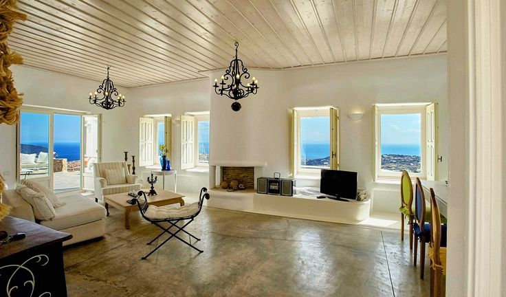 Dominating a hill and offering absolute privacy and commanding views over Super Paradise and Elia beaches this Castle like built ...