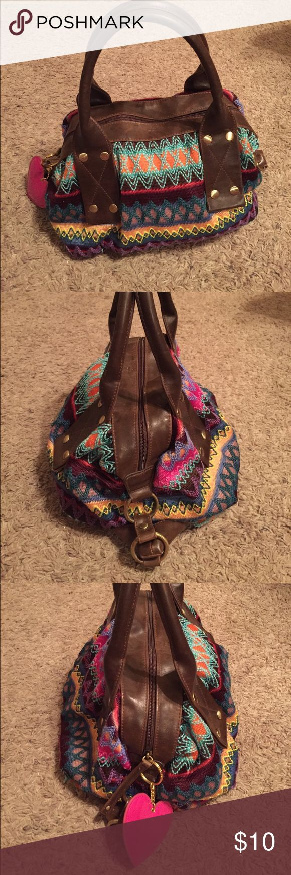 Boho handbag Cute little multicolored woven handbag, purchased from a little boutique a few years ago! Great condition! Removable heart keychain. Not urban outfitters, I don't think there is a brand. Urban Outfitters Bags Totes
