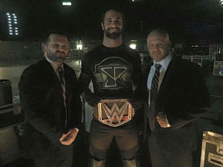 The WWE WHC, Seth Rollins, with Joe Mercury and Jamie Noble