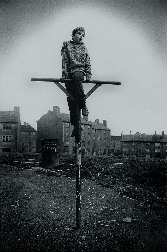 Boy on washing pole, Easterhouse, Glasgow. 1980s