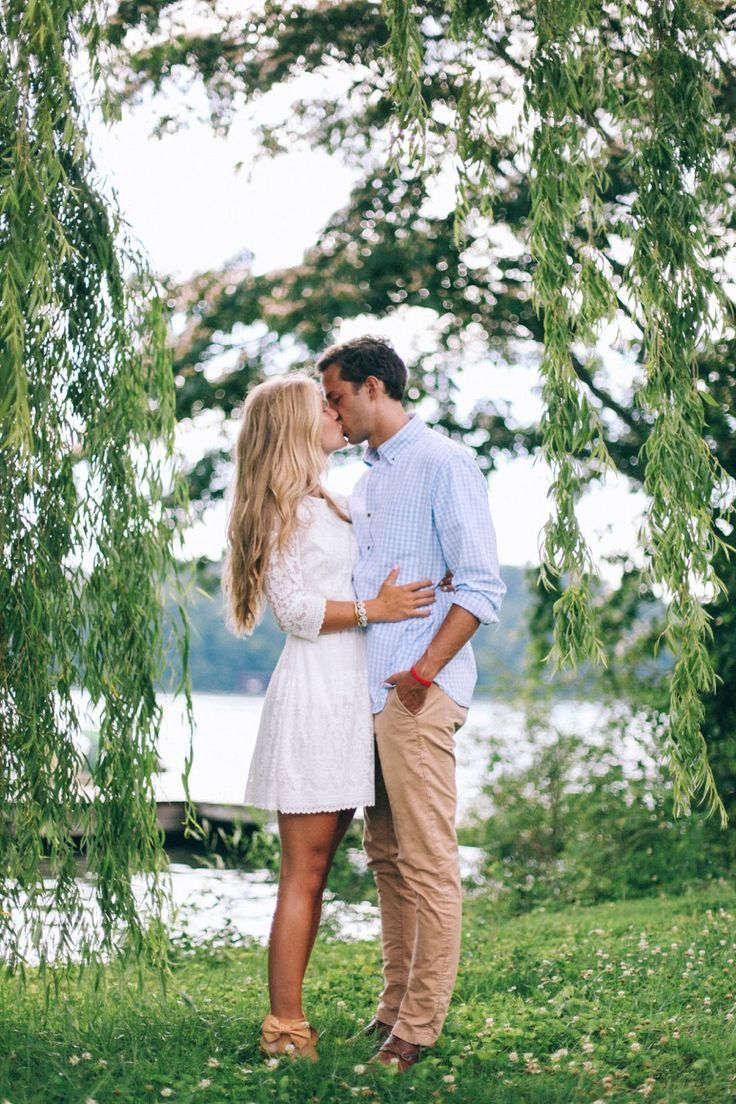 I'm a big fan of shorter white dresses for engagement sessions!  It gives a nod toward the upcoming wedding, and white is a great neutral color to compliment just about anything that he can wear.