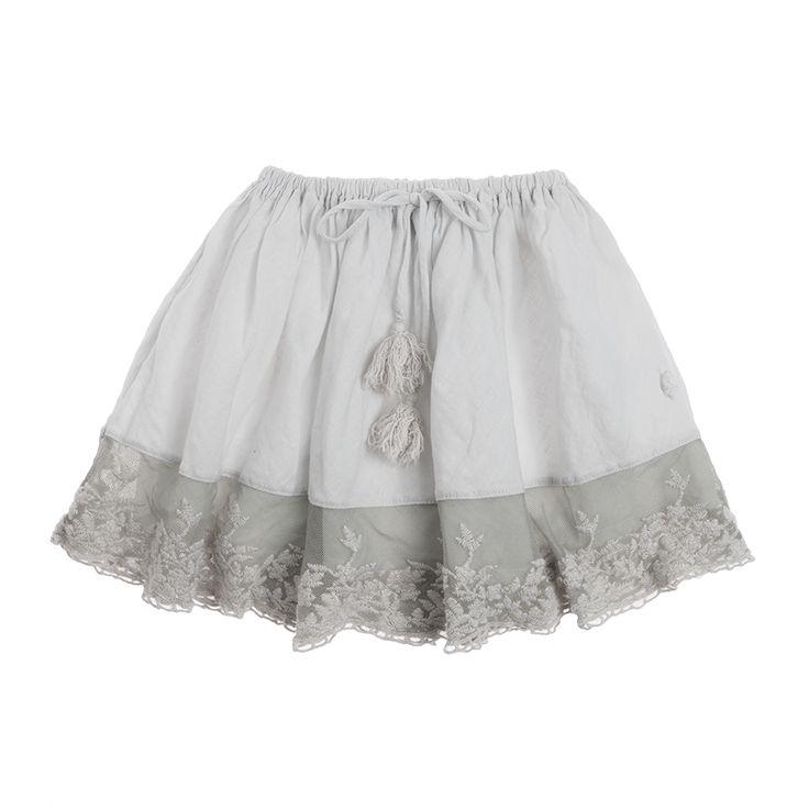 Falda de algodón con puntilla y lazo con pompones