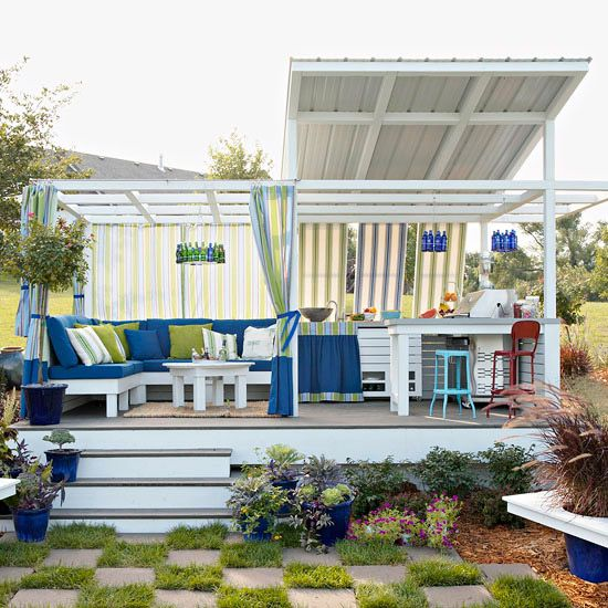 When creating an outdoor room, think comfort. For upholstered furniture, use outdoor fabrics and synthetic fill. All-weather curtains cast welcome shade from the sun.